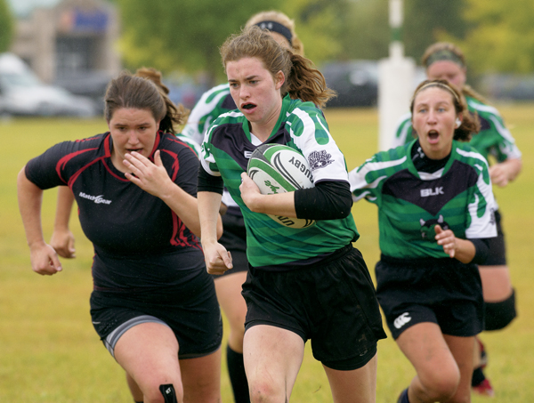 UND's Brooke Johnson breaks away from the MSUM defense during Saturday's rugby match. The Sweet Demons ended the match with a 26-10 victory.