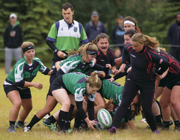 UND's Katie Krepp (front) scrambles after the ball during Saturday's rugby match against Minnesota State University-Moorhead. The Sweet Demons notched a hard-fought 26-10 victory at Jaycee's Park.