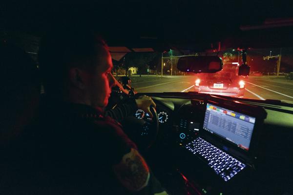 Sgt. Danny Weigel patrols University Avenue during his shift Saturday night.
