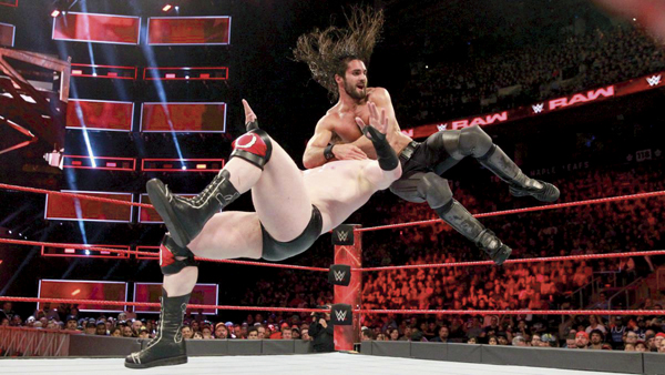 WWE superstar Seth Rollins slams Shaemus in a prior match.