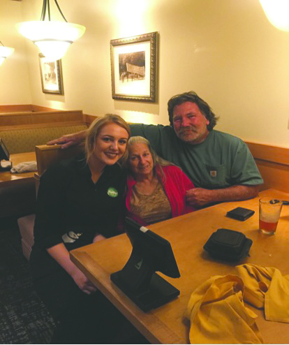 Michaela Schull with the table she served at Olive Garden