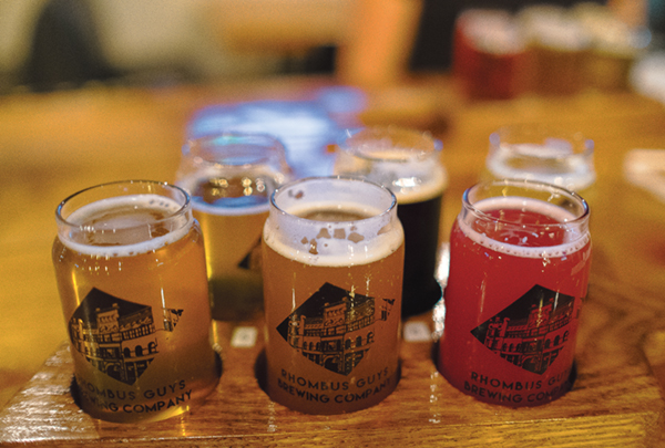 Rhombus Guys Brewing Company maintains core beers available to guests year-round but also has seasonal selections, including their Blackberry Boogie (front right).