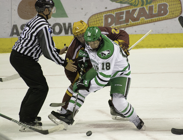 UND+forward+Collin+Adams+fights+for+puck+possession+with+Minnesota%27s+Tyler+Sheehy+during+Friday+night%27s+rivalry+game+at+the+Ralph+Engelstad+Arena.