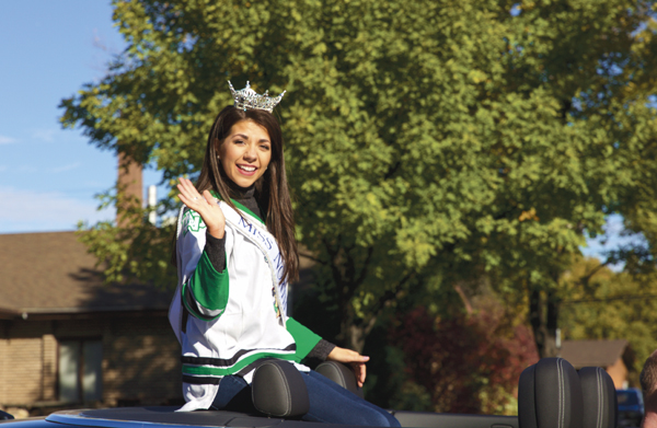 Miss North Dakota, Lizzie Jensen, waves to onlookers of the 2017 Homecoming parade Saturday morning in Grand Forks.