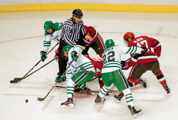 UND forward Nick Jones (#8) breaks away from a face-off against St. Lawrence Friday night at the Ralph Engelstad Arena. The Fighting Hawks swept the Saints in a two game series.