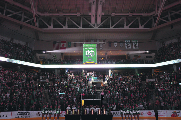 The 2016 NCAA championship banner is raised at the Ralph Engelstad Arena on September 30, 2016.
