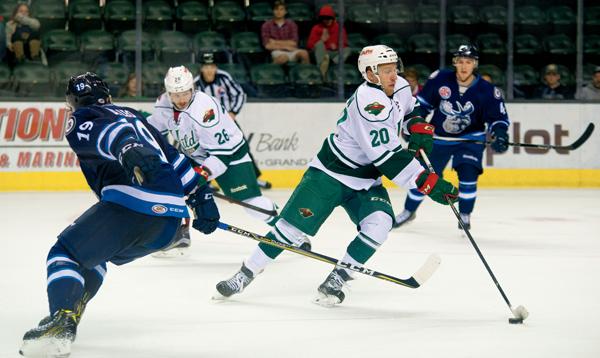 Iowa Wild right winger Gerald Mayhew evades Manitoba Moose defenders Friday night at the Ralph Engelstad Arena.