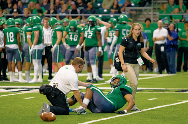 UND inside linebacker Donnell Rodgers winces in pain as a trainer attends to his injured knee during the 2017 Potato Bowl game against Missouri State on Saturday, September 9, 2017.