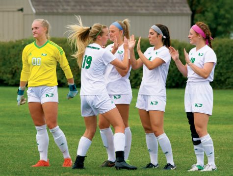 UND soccer defender Erin Svensson (#19) cheers with her teammates prior to a home match against Idaho State on September 22, 2017.