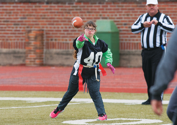 Special Olympics flags down football