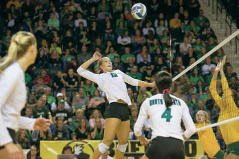 Middle hitter Faith Dooley jumps to spike the ball against NDSU last season at the Betty Engelstad Sioux Center.