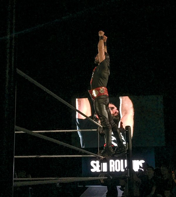 WWE wrestler Seth Rollins stands on the ropes during Friday's WWE event at the Alerus Center.