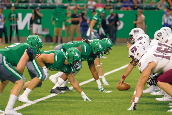 Fighting Hawks football players line up against Missouri State during this season's Potato Bowl football game at the Alerus Center.