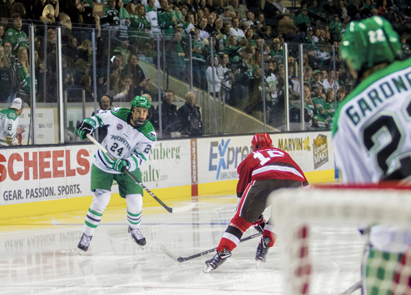 UND defender Christian Wolanin fires a shot towards the St. Lawrence goal during a home game earlier this season.