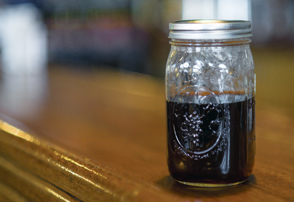 Using mason jars instead of plastic or paper cups to store beverages is an environmentally-friendly way to minimize disposable product use as a result of dining out at restaurants.