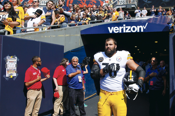 Alejandro Villanueva (#78) of the Pittsburgh Steelers stands by himself in the tunnel for the national anthem prior to the game against the Chicago Bears at Soldier Field on September 24, 2017 in Chicago, Illinois.