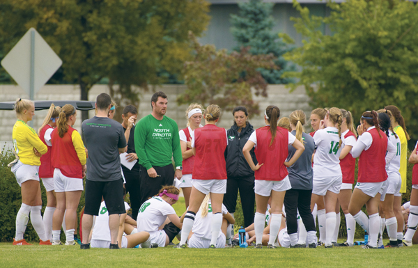 UND+head+soccer+coach+Chris+Logan+speaks+with+players+during+the+halftime+break+against+Idaho+State+earlier+this+season.