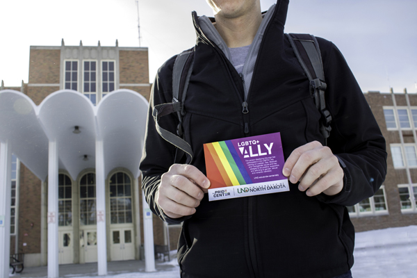 A UND student holds a placard after completing the LGBTQ+ Ally Training Program at the Memorial Union on Friday, January 26, 2018.
