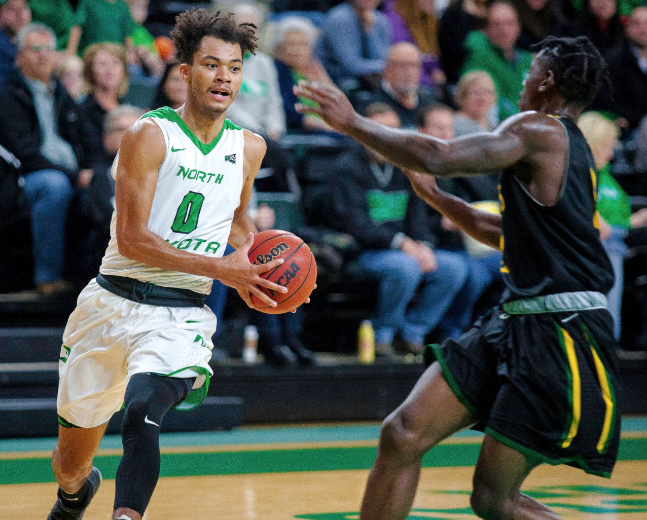UND guard Geno Crandall drives to the hoop against Presentation College earlier this season at the Betty Engelstad Sioux Center.