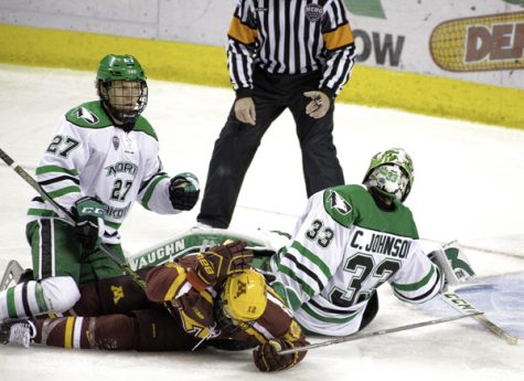 UND forward Ludvig Hoff (#27) watches goalie Cam Johnson makes a save against the Minnesoa Gophers earlier this season. Hoff was named to the Norwegian men