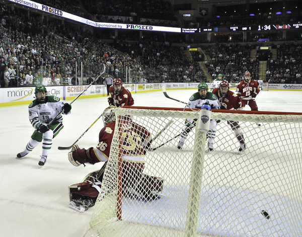 UND's Shane Gersich (#19) fires a shot past Denver goaltender Tanner Jaillet during a home series last season.