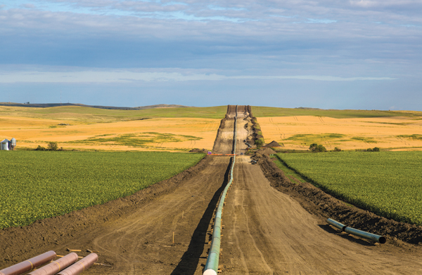 A pipeline installation between farms, as seen from 50th Avenue in New Salem, North Dakota on August 25, 2016.
