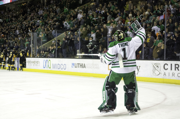 UND goalie Peter Thome celebrates Shane Gersich's goal in the second period of Saturday's hockey game against Colorado College at the Ralph Engelstad Arena.