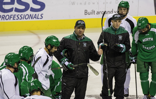 UND head coach Brad Berry leads the men's hockey team in a practice last season at the Ralph Engelstad Arena.