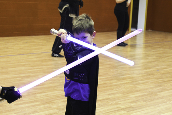 Liam Coons spars with a lightsaber combat instructor at LudoSport Grand Forks on Friday, February 2, 2018.