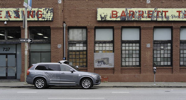 A self driving Volvo XC90 is parked outside 737 Harrison, the unmarked headquarters of Otto, a San Francisco, Cali. autonomous trucking company acquired by Uber in 2016. Dllu / Wikimedia Commons