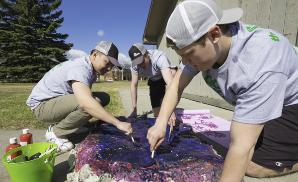 (From left) Alan Ju, Alex Widner and Devin Reifsteck paint