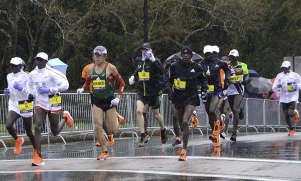 Runners near the halfway point of the 2018 Boston Marathon near Wellesley, MA on April 16, 2018.