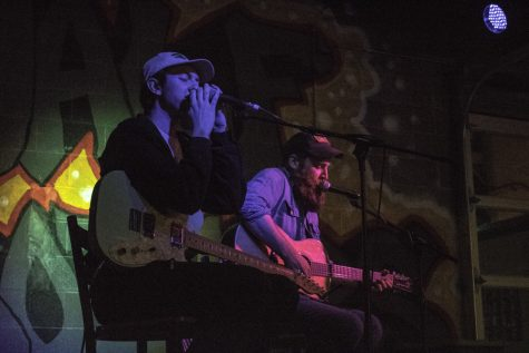 Minneapolis musician Joe Kopel (left) and David Allen, from Hatton, N.D., took the stage Friday night at Half Brothers Brewing Company in downtown Grand Forks.